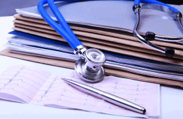 medical records and a stethoscope