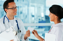 doctor giving a card to a patient